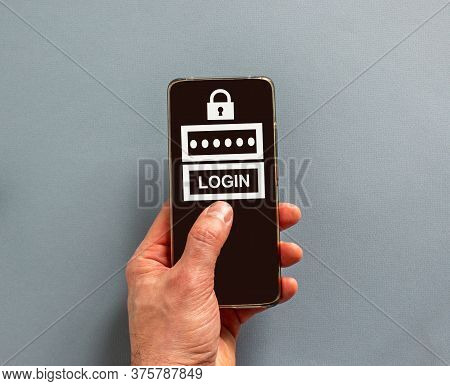 Male Finger Clicks On Smartphone Screen With A Word 'login' On The Blue Background.  Lock Sign. Copy