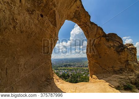 Rock Formations Formed An Arch In The Form Of A Ring On The Top Of The Mountain