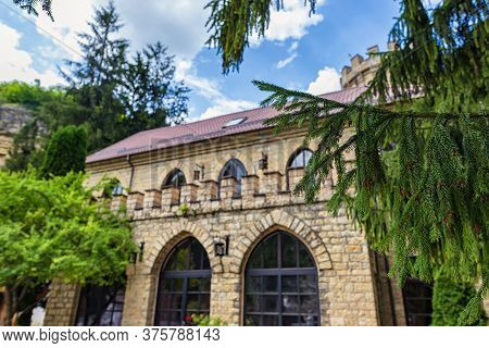 The Restaurant Building And Surrounding Areas Are Decorated In The Style Of A Medieval Castle