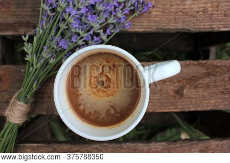 Cup Of Coffee With Milk Or Cappuccino And Lavender Flowers On Wooden Board In Summer Garden. Enjoyin