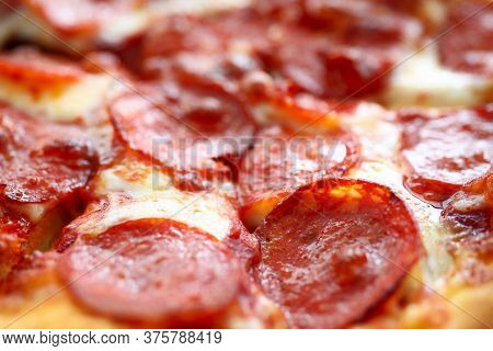 Close-up Of Fresh Baked Pizza With Sausage, Tomato Sauce And Cheese. Delicious Food And Fastfood Con
