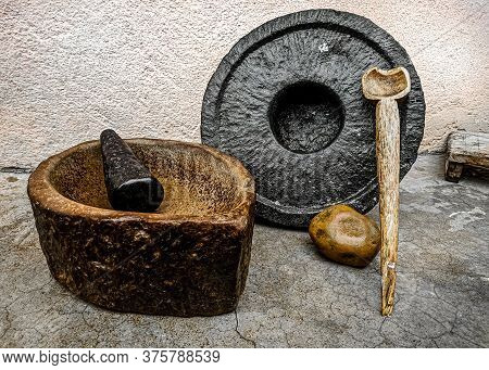 Ancient Indian Grinding And Crushing Tools Made From Stone With A Wooden Spoon.