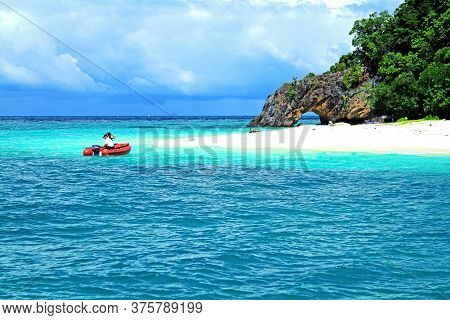 Tourist Taking A Red Boat To The Island On Andaman Sea, Krabi, Thailand. Beautiful Deep Sea And Whit