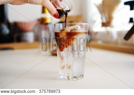 Making Espresso Tonic. Pouring Espresso Into Glass With Tonic And Ice