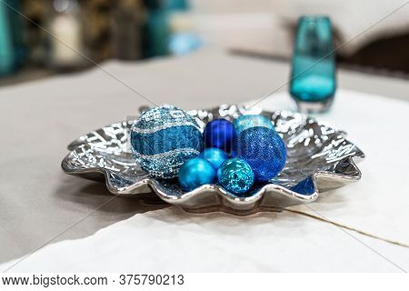 Beautiful Still Life With Round Blue Christmas Decorations. New Year Decorations On Silver Plate Ind