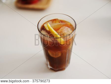 Espresso Tonic With Lemon Slice In Bid Glass With Ice