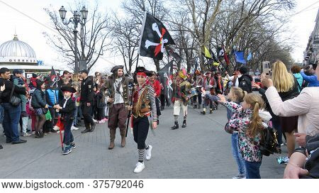 Odessa, Ukraine - 04 01 2019: Children Greet Costumed Young Pirates On The Central Boulevard Of The
