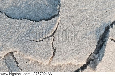 Sand On The Beach As Background. Sand Texture. Top View. Close Up Of Sand. Beautiful Sand Background