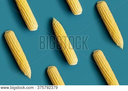 Minimal Pattern With Cob Of Corns. Diagonal Lines Of Corn Cobs On Blue Background
