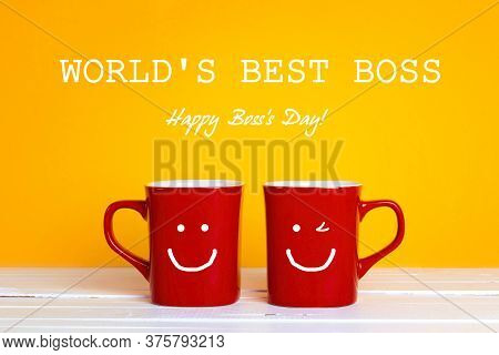 Boss Day Greeting Card With Two Red Coffee Mugs With A Smiling Faces On A Yellow Background. Happy B