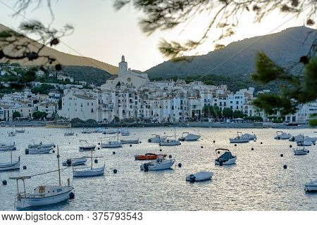 Cadaques, Spain : 07 July 2020 : Boats In The Beach And Houses Of The Village Of Cadaques, Spain In