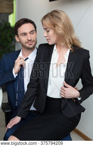 Adorable Blonde Flirts With Boss In Office, Sitting On His Lap. Businesswoman Seducing Coworker At O