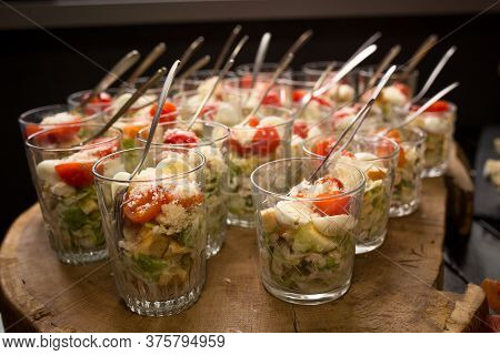 Fresh Salad In Glasses. Starter Appetizer Table. Banquet Or Event In Cafe. Holiday Or Event Treats.