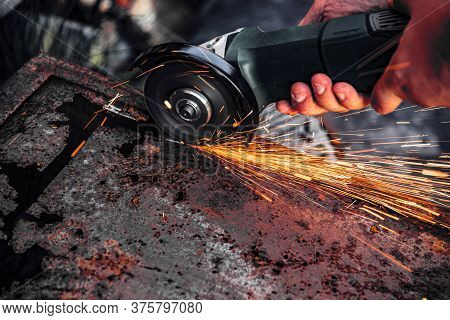Manual Metal Sawing, Sparks While Grinding Iron, Close Up