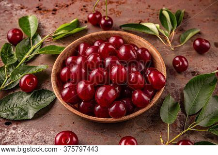 Delicious Ripe Sweet Cherries Composition On Rusty Metal Background