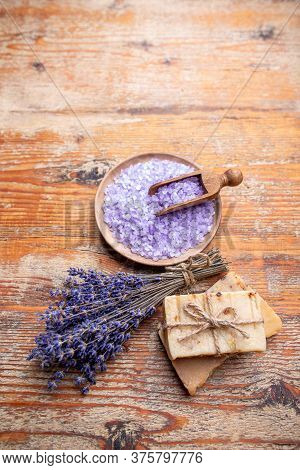 Lavender Flowers, Bar Of Soup And Lavender Aromatic Sea Salt On Rustic Background