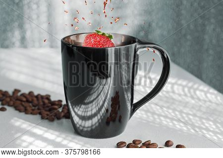 Coffee In A Mug And Strawberries With A Splash. Against The Background Of Openwork Shadows From The
