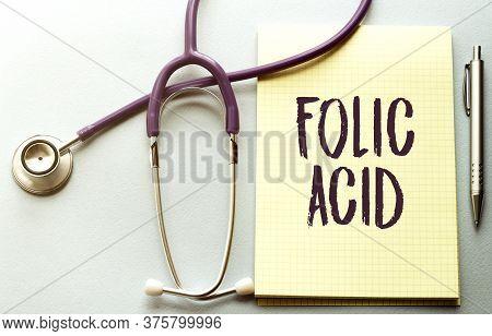 Folic Acid Written On A Clipboard, Medical Concept