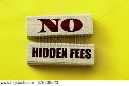 No Hidden Fees Words On Wooden Block. Taxes And Penalties Financial Concept