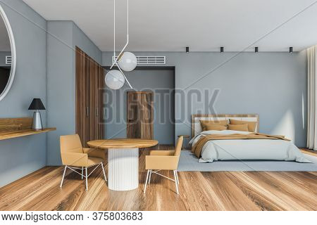 Interior Of Stylish Master Bedroom With Gray Walls, Wooden Floor, Comfortable King Size Bed With Rou