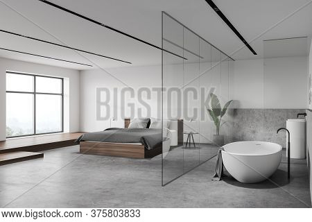 Corner Of Modern Hotel Bedroom With White And Stone Walls, Stone Floor, Comfortable King Size Bed An