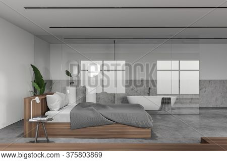 Side View Of Modern Hotel Bedroom With White And Stone Walls, Stone Floor, Comfortable King Size Bed
