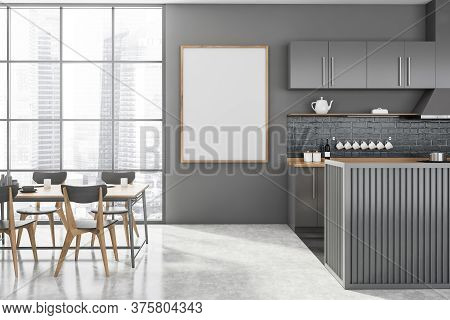 Interior Of Modern Kitchen With Gray Walls, Concrete Floor, Gray And Wooden Island And Dining Table