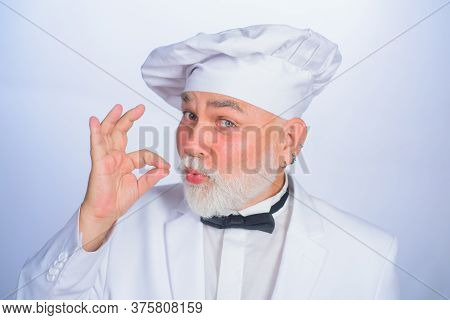 Male Chef In White Uniform With Perfect Sign. Cook With Taste Approval Gesture. Professional Chef Ma