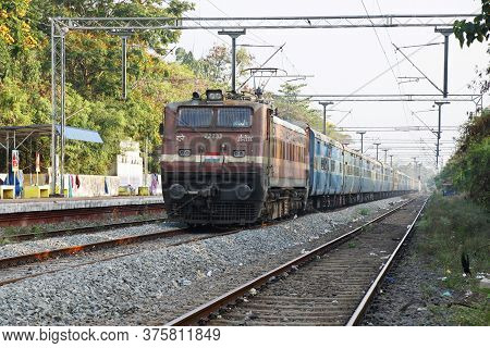 Kochi, Kerala, India -january 21, 2020 A Train Moving With Electric Support Through The Track In Ind