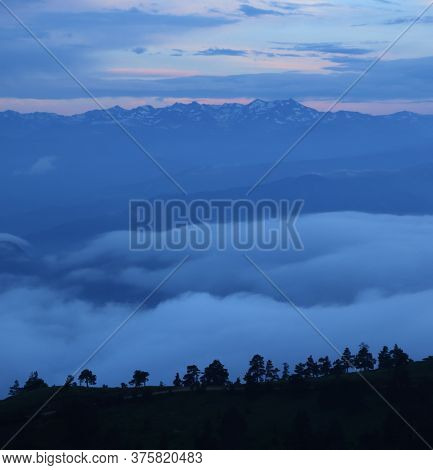 Foggy Mountains Against Snowy Tops In Trabzon,turkey.