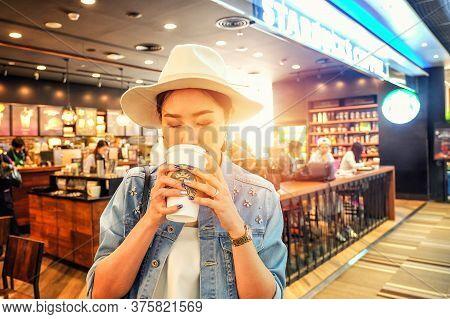 Bangkok September 07 2016 :woman At Starbucks Coffee At Don Mueang International Airport. Starbucks