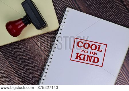 Red Handle Rubber Stamper And Cool To Be Kind Text Isolated On The Table.