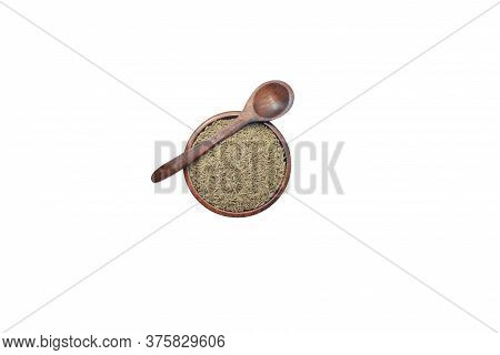 Jeera Cumin Seeds Spices Of Kerala Inside A Wooden Bowl Along With Wooden Spoon  On White Background