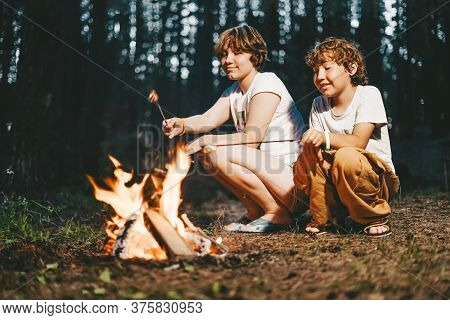 Children Brother And Sister Siblings Roasted Marshmallows On Fire At The Campsite