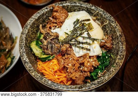 Traditional Korean Hot Stone Bi Bim Bap Rice Dish Mixed With Vegetables, Beef And Egg