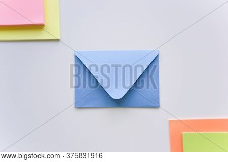 Selective Focus, Blue Envelope In The Center With Bright Colored Rectangles In Corners