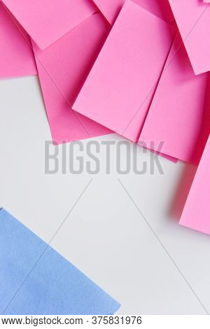 Selective Focus, Pink Stickers In One Corner And Blue One In The Opposite Corner. Opposition Concept