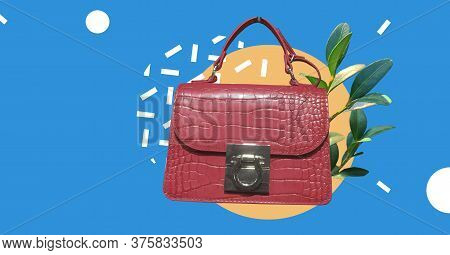 Small Red Leather Mock Croc Tote Bag With Plants Isolated On Abstract Colorful Background. Woman Ele