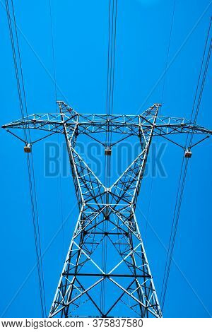 Power Line Pylon With High Voltage Wires Bottom Up View Opposite Sky