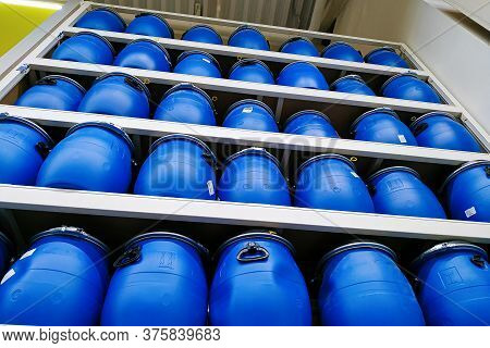 Moscow, Russia - August 17, 2019: Many Large Blue Plastic Barrels On The Rack In A Building Material
