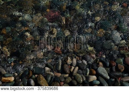Sea Pebbles Under Clear Water Near The Shore With Reflection Of Sunlight. Screensaver,  Design Pictu