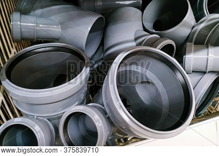 Moscow, Russia - August 17, 2019: Grey Plastic Connectors And Adapters For Large Plumbing Pipes On T