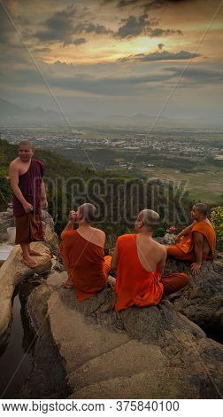 Nha Trang, Vietnam - Jul 10, 2020. Buddhist monks sitting on the top of hill at Suoi Do pagoda in Nha Trang, Vietnam