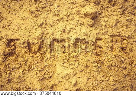 Closeup Shot To Summer Word Written In Sand Texture On A Beach In Summer