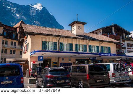 Grindelwald, Bernese Oberland Switzerland - July 30 2019 : Main Railway Station Building On Bright S
