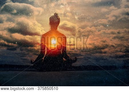 Yoga Day Concept. Multiple Exposure Image. Clouds And Sun. Pranayama In Lotus Asana.