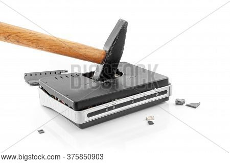 Hammered Internet Router With Splinters Around It On A White Background. Internet Abandonment Day. D