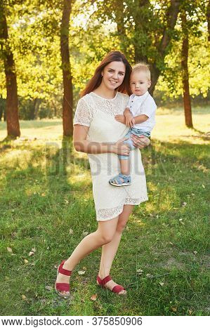 Autumn Family Walk In Forest. Happy Mother And Baby Boy. Family With Little Son In Autumn Park. Fami