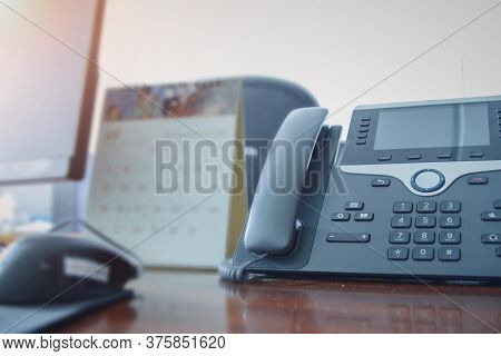 Close Up Telephone Devices Background At Call Center Office Desk In Workspace Room And Computer For