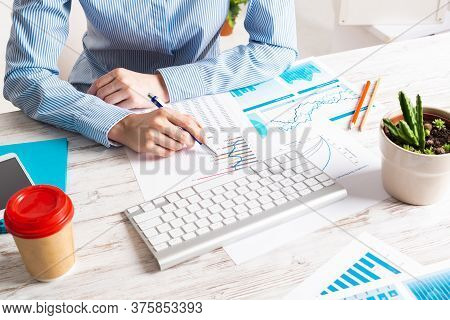 Business Consultant Sitting At Desk And Analyze Financial Report. Strategy Planning And Investment.